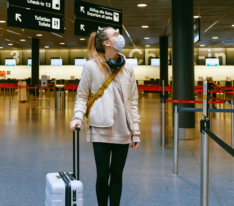 A young traveler in an airport during COVID-19